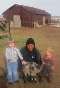 Maeve, Tiarnan and Filo, with twin lambs