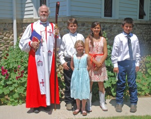 Bishop Smylie with confirmees Wyatt Duncan, Siobhan Lally, Taylor Duncan and Thomas Duncan.