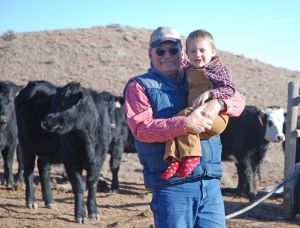 Pat and McCoy with the heifers