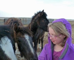 Siobhan feeding colts