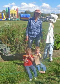 Museum Director Leila Emmons with McCoy , Tiarnan, and the garden planted with the kids on Pioneer Day