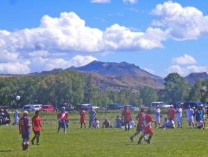 Peruvian soccer game in the hayfield next to the Little Snake River Museaum