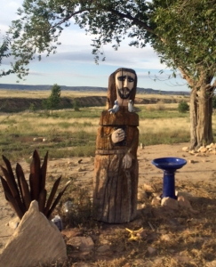 St. Francis overlooks the ranch headquarters, and the Tuda Libby Crews Bird Sanctuary..