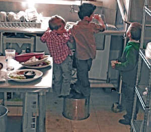 Rhen and Gael washing dishes--McCoy supervising, at El Rio Restaurante  in Baggs