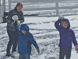 Sharon, Seamus, and Maeve gathering snow